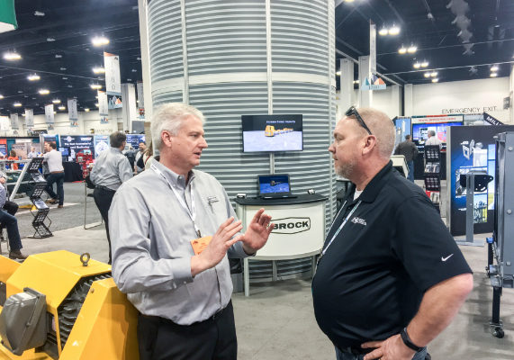John Tuttle, left, Brock Grain Systems visits with Rick Krier, Central Valley Ag Cooperative.