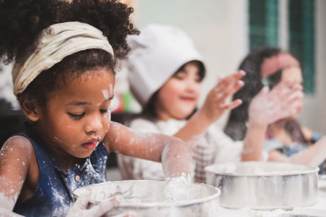 Photo of children playing with flour