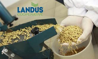 Landus-coop_logo-on-feed-manufacturing-machine