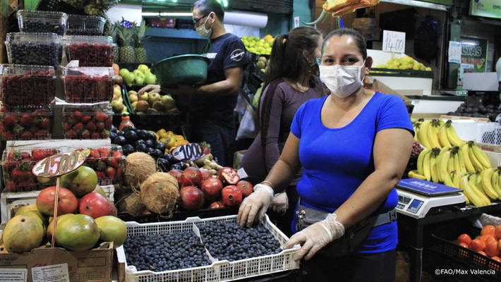 vendor wears a protective mask