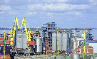 Cargo crane and grain dryer in port odessa ukraine photo cred adobestock 56835352 e