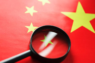 China flag with magnifying glass photo cred adobe stock e