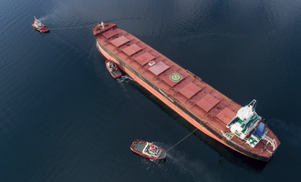 Ship being towed adobestock 222182342 e