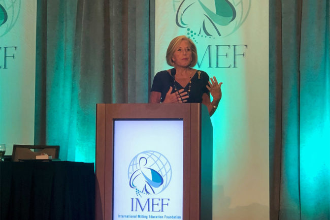 Cordia Harrington of Crown Bakeries speaks at IMEF Breakfast at 125th IAOM Conference and Expo